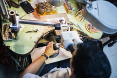 Jeweler working with optical device Royalty Free Stock Photos