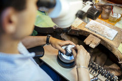 Jeweler working with optical device Royalty Free Stock Photography