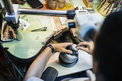 Jeweler working with optical device Stock Photography