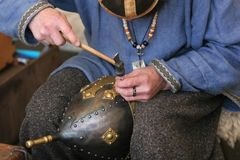 Jewelers handiwork. A craftsman making an armored medieval soldiers helmet Royalty Free Stock Photos