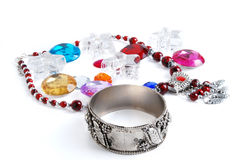 Jewelery & beads. Bracelet jewelery and different color of beads isolated on a white background Stock Image