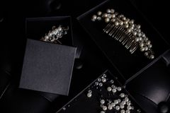 Jewelery from beads in box. Beautiful jewelery of beads for hair on black box. Black table Royalty Free Stock Image