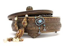 Jewelery box. An old jewelery box with old jewels in it over a white background stock image