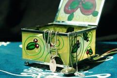Jewelery box. A glass jewelery box on a vintage chair Stock Photo