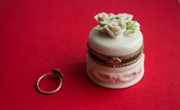 Jewelery box and ring. On red background Stock Photography