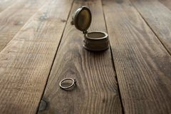Jewelery box and ring. On a wooden background Royalty Free Stock Images