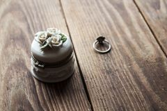 Jewelery box and ring. On a wooden background Stock Images