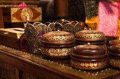 Jewelery cases. Wooden jewelery boxes with metal ornaments standing on a carved table on a market Stock Photo