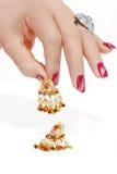 Jewelery in der Hand Stockbild