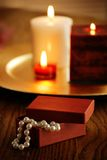 Jewelery gift box and candles Royalty Free Stock Images