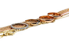 Jewelery gold objects on white Stock Photos