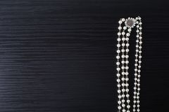 Jewelery for hair and white earrings made of beads on a dark background. stock images