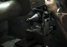 Jewelery making. Close up of machining a golden ring Royalty Free Stock Photo