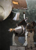 Jewelery making. Close up of machining a golden ring Royalty Free Stock Image