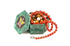 Jewelery in  malachite box isolated on white Royalty Free Stock Image