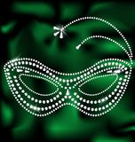Jewelery mask. On a green silk is a jewelery carnival mask Stock Images