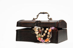 Jewelery in old wooden box Royalty Free Stock Image