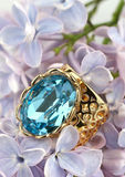 Jewelery Ring with big gemstone on flower Royalty Free Stock Photography