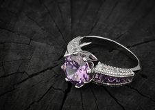 Jewelery ring with gem on black wood background, copy-cpace Stock Photography