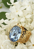 Jewelery Ring with gemstone on white flower Royalty Free Stock Images