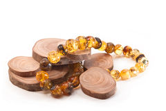 Jewelery for women. Amber necklace and ring sections of the tree on a white background Royalty Free Stock Photography