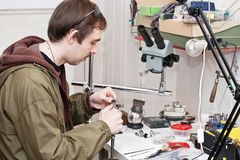 Jeweller. Male jeweller is working at jeweller's workshop Royalty Free Stock Photo