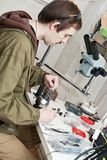 Jeweller. Male jeweller is working at jeweller's workshop Royalty Free Stock Images