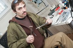 Jeweller. Male jeweller is working at jeweller's workshop Royalty Free Stock Photography