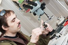 Jeweller. Male jeweller is working at jeweller's workshop Stock Images