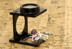 Jeweller. Loupe and a Diamond stock photos