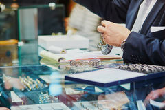 Jeweller with many wedding ring samples Stock Photos