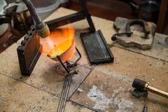 Jeweller melts gold. Gas burner Stock Photography