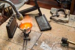 Jeweller melts gold. Gas burner Stock Image