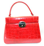 Jeweller red leather. Handbag shaped Royalty Free Stock Photos