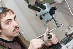 Jeweller is working. Male jeweller is working at jeweller's workshop Royalty Free Stock Images