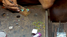 Jeweller working with earrings Royalty Free Stock Image