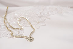 Jewellery #1. Bridal jewellery on wedding gown royalty free stock image