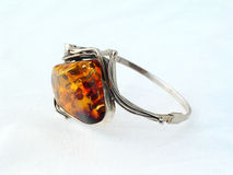 Jewellery. Piece of jewellery. Amber and silver Royalty Free Stock Image
