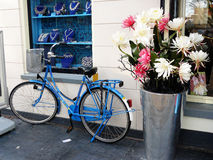 Jewellery. A shop window of a jewellery with a bike and a vase with synthetic flowers in front Royalty Free Stock Image