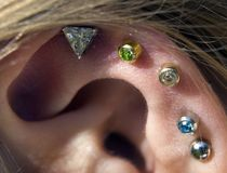 Jewellery. Ear full of different jewellery Royalty Free Stock Image