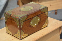 Jewellery. Beautiful wood box for keeping jewellery and memories. Wood and brass Royalty Free Stock Photography