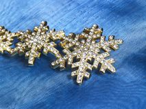 Jewellery in blue fabrics background Royalty Free Stock Image