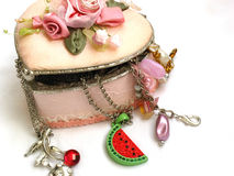 Jewellery box. A pink decorated jewellery box filled with jewels Stock Photography
