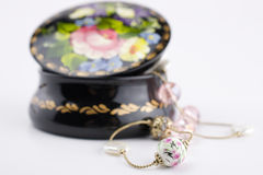 Jewellery box and beautiful necklace. Traditional ukrainian handmade jewellery box and beautiful necklace Royalty Free Stock Photography