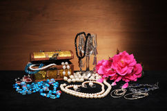 Jewellery box and flowers Stock Images