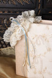Jewellery Box and Garter. Cream Colored Jewellery box and bridal garter Royalty Free Stock Photography