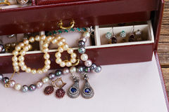 Jewellery in box. Vintage Jewellery in treasure box on table close up royalty free stock photos