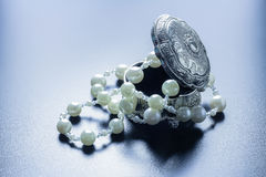 Jewellery box with white pearls with studio lights Stock Photography