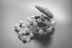 Jewellery box with white pearls with studio lights Royalty Free Stock Image