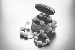 Jewellery box with white pearls with studio lights Royalty Free Stock Images